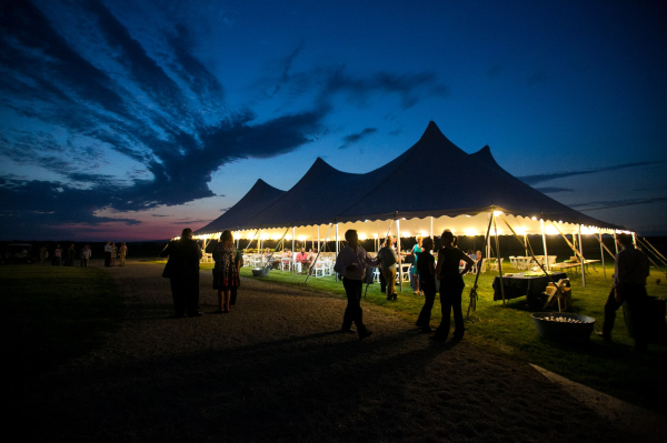 Wedding reception tent at dusk