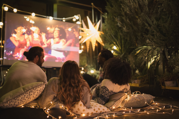 Outdoor movie theater for graduation celebration
