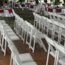 White folding chair rentals for Wisconsin wedding reception.