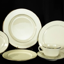 Place setting of china plates for rent.