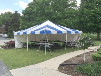 Blue and white striped event tent