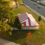 30x60 Red & White Striped Party Tent with fenced area